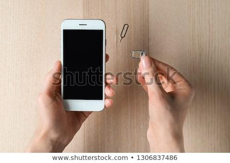 Person Inserting Sim Card In Cellphone Stock photo © AndreyPopov