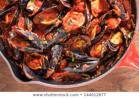 delicious mussels with tomato sauce stock photo © karandaev