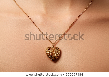 beauty and jewelry concept   woman wearing shiny gold pendant c stock photo © serdechny