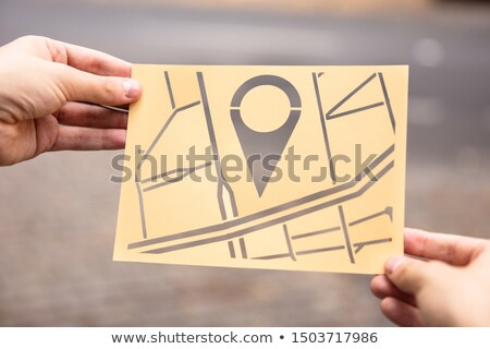 Hands Holding Paper With Cutout City Map Stock photo © AndreyPopov
