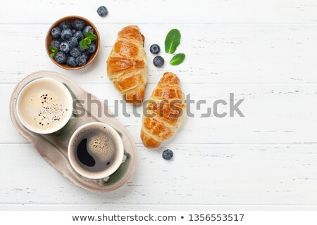 Two buns with cup of coffee Stock photo © Alex9500