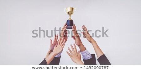 Lavoro di squadra uomini donne oro trofeo Foto d'archivio © robuart