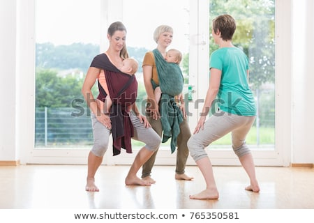 Mothers exercising with babies at postnatal exercise course Stock photo © Kzenon