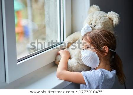 Little girl ursinho de pelúcia máscara janela Foto stock © Illia