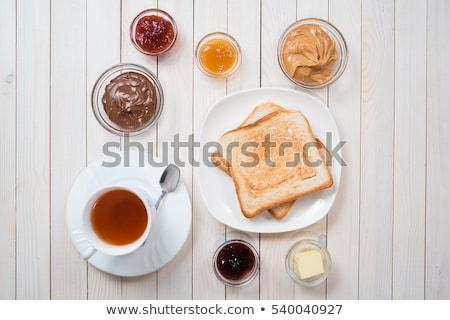 - 1519007_stock-photo-bread-butter-jam-on-white-plate