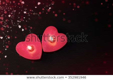 burning heart shaped candle and a card stock photo © andreykr