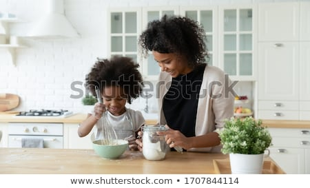 two funny housewifes with  kitchen utensil  Stock photo © marylooo