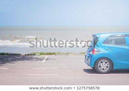 Stock photo: Couple in parked car at the seaside