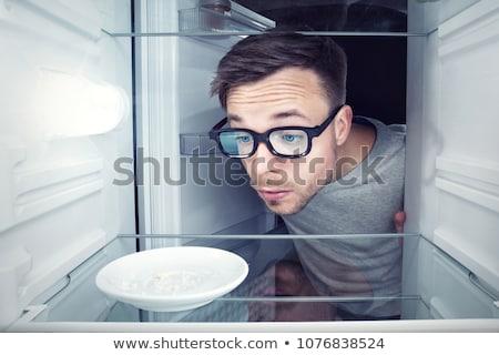 vuota · frigorifero · giovani · triste · donna · guardando - foto d'archivio © vinogradov