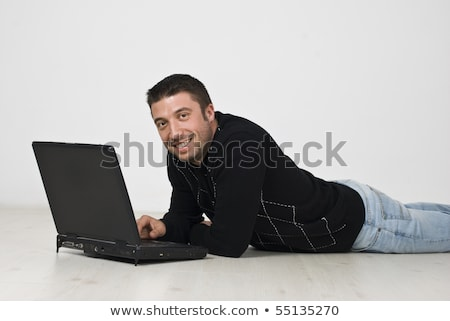 Man with laptop laying laminate flooring Stock photo © photography33