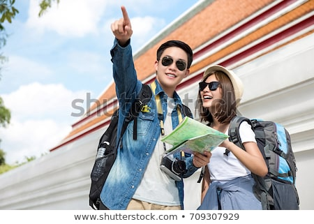 Man looking at map on wall Stock photo © photography33