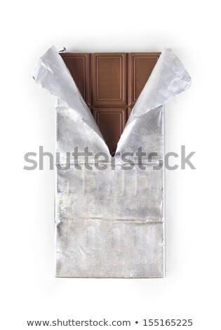 Chocolate bar with torn wrapper Stock photo © sumners