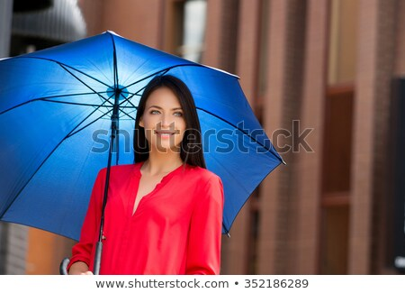 Brunette with umbrella stock photo © photography33