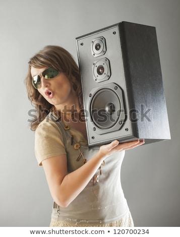 Beautiful woman holding big wooden speaker Stock photo © Amaviael