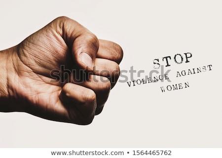 Agressor sorridente menina agressivo mãos cara Foto stock © dolgachov