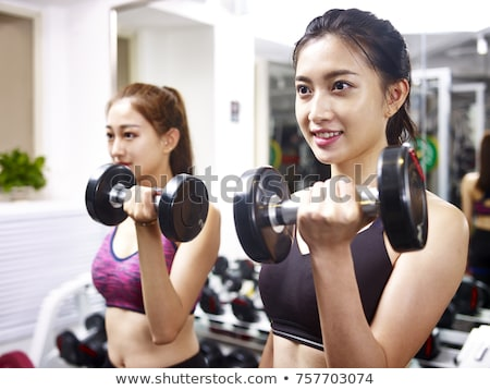 beautiful asian woman using dumbbells stock photo © stryjek