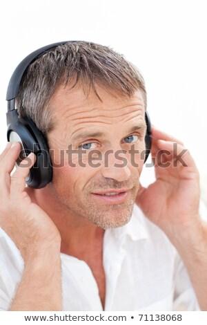 man · luisteren · muziek · home · ontspannen · glimlachend - stockfoto © wavebreak_media