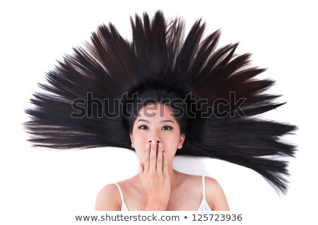 Asian girl lying on white with scatter hair Stock photo © szefei