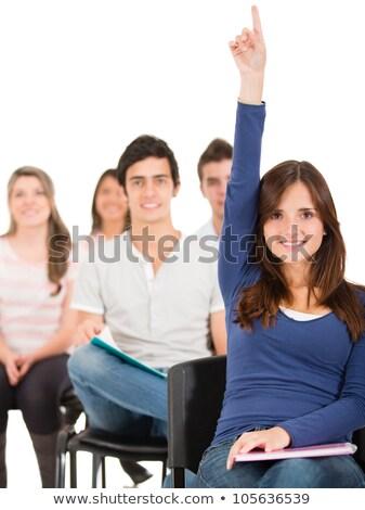 Cheerful university student raising her hand Stock photo © stockyimages