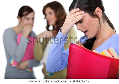 two female colleagues mocking a woman in trouble Stock photo © photography33