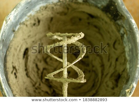 Builder mixing substance in bucket Stock photo © photography33