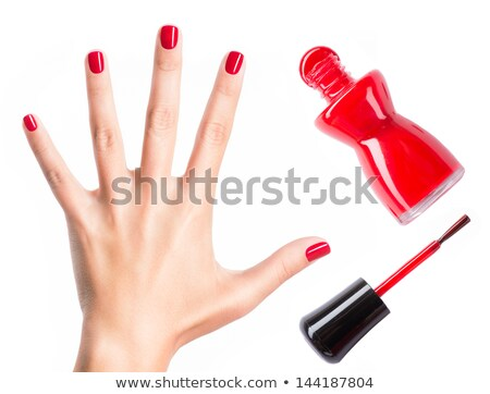 A bottle of red nail polish in a female hand Stock photo © RuslanOmega