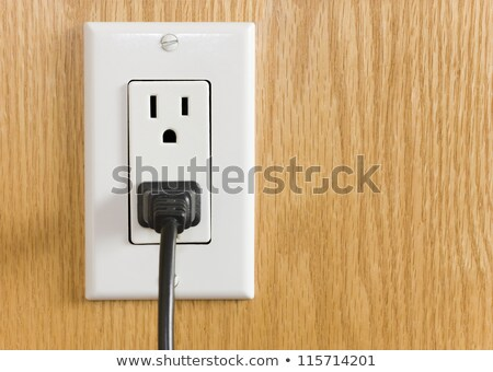 Inserting Power Cord Receptacle in wall outlet  Stock photo © tab62