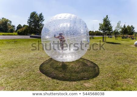 Nino diversión pelota hierba verano adolescente Foto stock © meinzahn