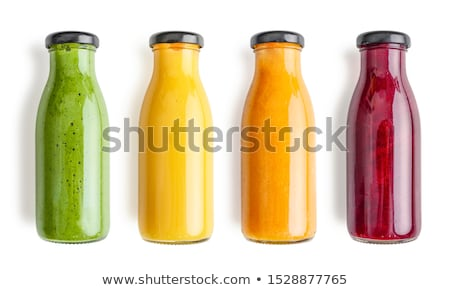 Fresh bottle of juice with fruits isolated on white stock photo © anmalkov