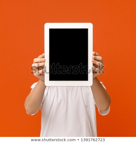 Stock photo: Hide the face behind digital tablet