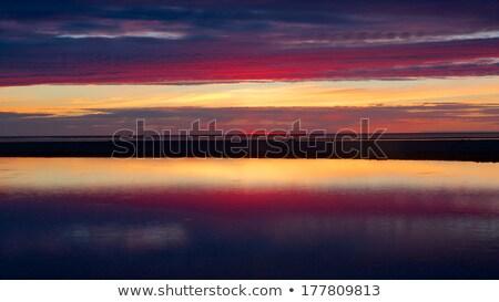 Mavi kırmızı gün batımı güzel plaj gökyüzü Stok fotoğraf © miracky