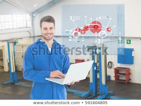 Szczęśliwy mechanik za pomocą laptopa portret biały technologii Zdjęcia stock © wavebreak_media