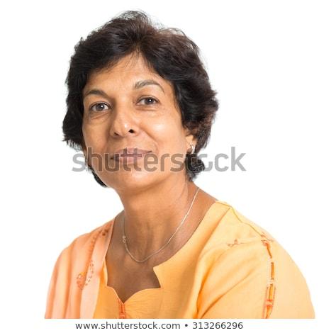 ストックフォト: 肖像 · インド · 成熟した女性 · 幸せ · 50年代 · 笑みを浮かべて