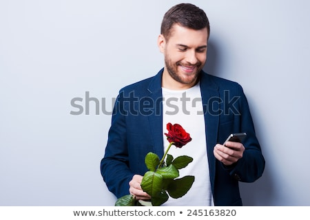 smart man holds his hands in his pockets while his girlfrend res stock photo © feedough