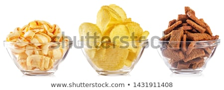 Potato chips and glass of beer isolated on white Stock photo © tetkoren
