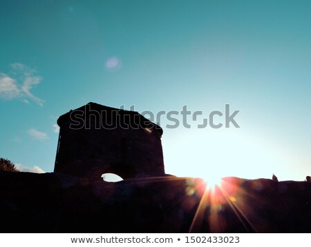 Sunset by the fortified bridge Stock photo © rmbarricarte