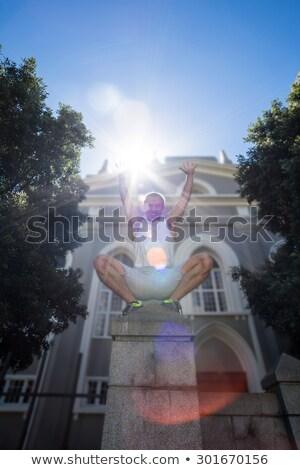 Extreme athlete crouching on pillar Stock photo © wavebreak_media