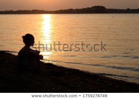 Seashore silhouette and sunset Stock photo © artfotodima