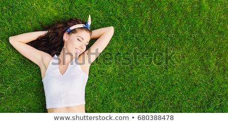 gelukkig · vrouw · gras · asian · glimlachend · meisje - stockfoto © deandrobot