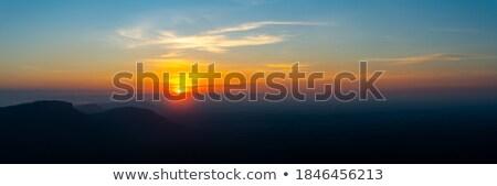 sundown sky and mountains range background stock photo © taiga