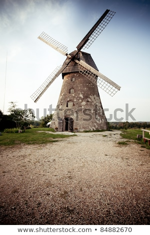 Traditional dutch windmill in Latvia Stock photo © 5xinc