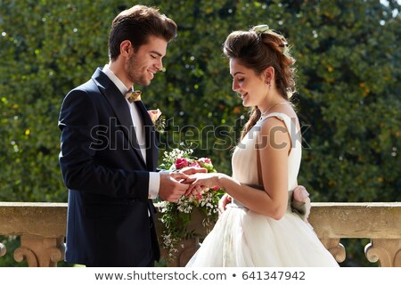 Groom puts the ring on the bride hand. Stock photo © Zhukow