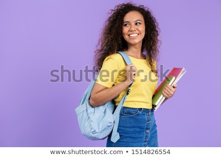 portrait of a joyful brown haired student girl standing stock photo © deandrobot