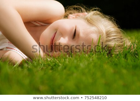 Head shot of a girl lying on a lawn Stock photo © IS2