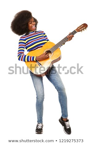 Young african woman playing the acoustic guitar. Stock photo © RAStudio