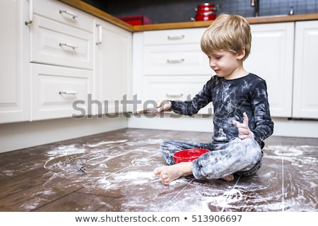 Boy sitting in a messy kitchen Stock photo © IS2
