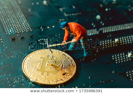 A Worker Mining Cyber Coin Stock photo © bluering