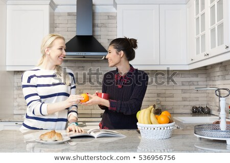 Two women talking at dinner table Stock photo © IS2