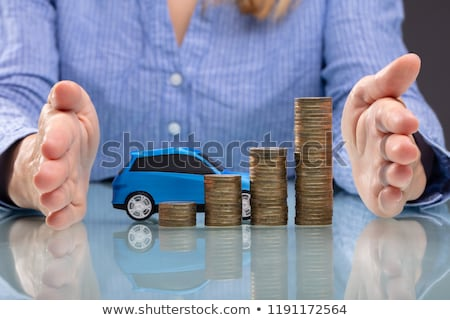 Businesswoman Protecting Stacked Coins And Blue Car Stock photo © AndreyPopov