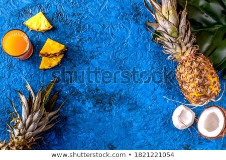 Pineapple pieces on blue desk  Stock photo © dash
